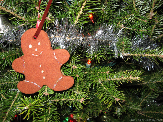 gingerbread man ornament hanging on christmas tree